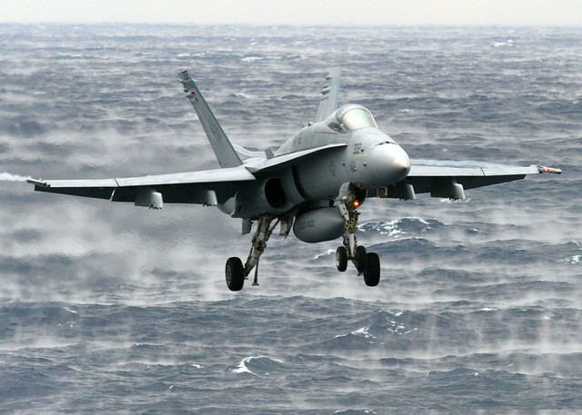 View of a US Navy (USN) F-18C Hornet fighter aircraft, Strike Fighter Squadron 15 (VFA-15), Valions, Naval Air Station (NAS) Oceana, Virginia (VA), as it makes its final approach to the USN Nimitz Class Aircraft Carrier USS HARRY S. TRUMAN (CVN 75) carrier deck. The TRUMAN is currently undergoing carrier qualifications and flight deck certification off the Atlantic coast