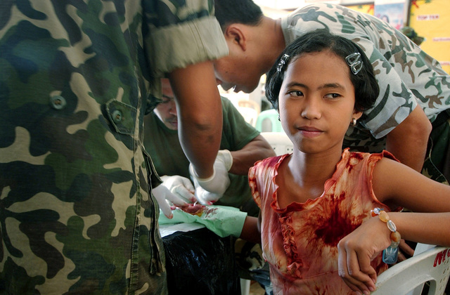 A young girl receives medical aid from military personnel participating in the Medical Civic Action Program (MEDCAP) in Bargangay San Miguel as a part Exercise BALIKATAN 2004. The MEDCAP staffed by the medical doctors, dentists, nurses and veterinarians from both the Republic of the Philippines (RP) and US Armed Forces provide much needed medical and dental services to the residents of eight Barangays (Townships); Mandaragat, San Miguel, Model, Milagrosa, Sta. Lourdes, Irawan, Luzviminda and Tiniguiban