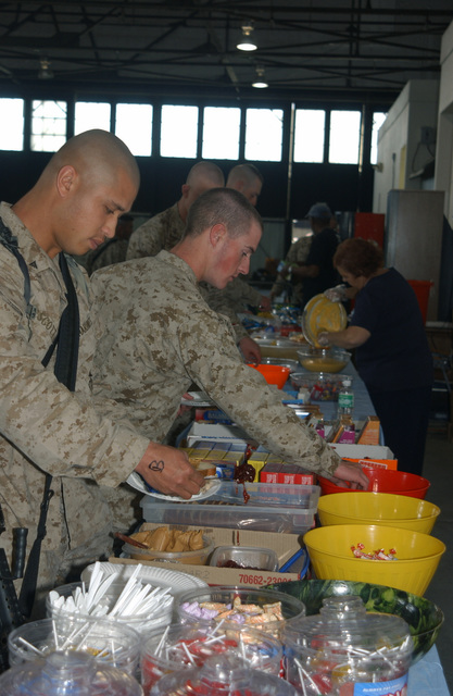 US Marine Corps (USMC) personnel from the 1ST Force Service Support Group (FSSG) are served snacks by Family Support community volunteers at March Air Reserve Base (ARB), California (CA). The Marines are processing through March ARB, California (CA), prior to deployment to Iraq (IRQ), in support of Operation IRAQI FREEDOM