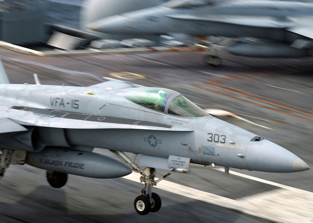 A US Navy (USN) F/A-18C Hornet fighter aircraft, Strike Fighter Squadron 15 (VFA-15), Valions, Naval Air Station (NAS) Oceana, Virginia (VA), coming for an arrested landing on the flight deck aboard the Nimitz Class Aircraft Carrier USS HARRY S. TRUMAN (CVN 75). The TRUMAN is currently undergoing carrier qualifications and flight deck certification off the Atlantic coast