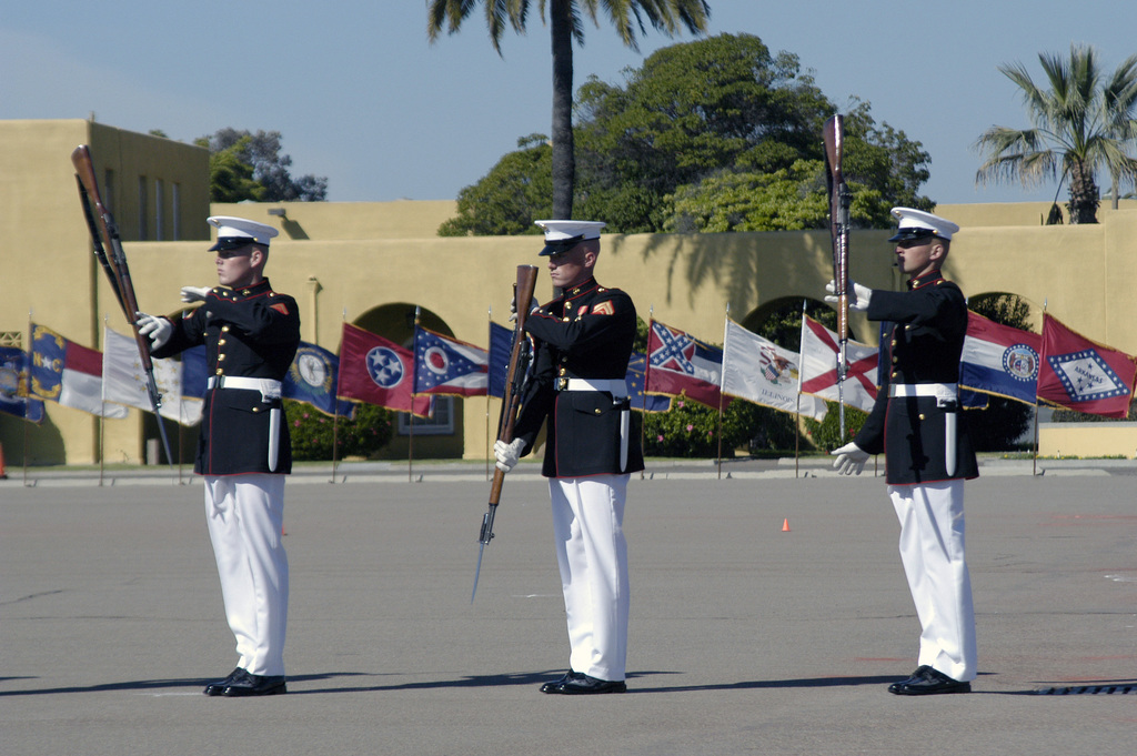 Three US Marine Corps (USMC) Marines of the USMC Silent Drill Platoon perform during the Battle Colors Ceremony held at Marine Corps Recruit Depot (MCRD) San Diego, California (CA)