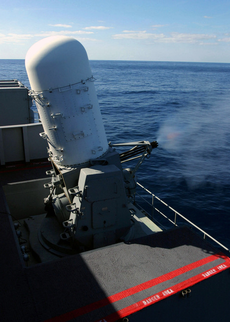 A MK 15 Phalanx Close-In Weapons System (CIWS) mount fires live rounds during a Pre-Aim Calibration Fire (PACFIRE) aboard the USN Nimitz Class Aircraft Carrier USS HARRY S. TRUMAN (CVN 75). The CIWS is a fast-reaction, rapid-fire 20mm gun system for short-range defense against aircraft or missiles. The TRUMAN is currently undergoing carrier qualifications and flight deck certification off the Atlantic coast