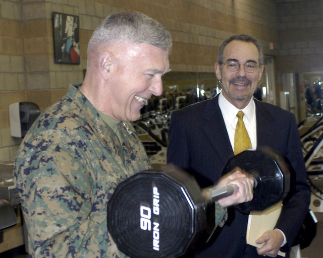US Marine Corps (USMC) Lieutenant General (LGEN) James T. Conway (foreground), Commanding General, 1ST Marine Expeditionary Force (MEF), uses the free weights to get in a quick workout during the grand opening of the Semper Fit Field House at Marine Corps Base (MCB), Camp Pendleton, California (CA)
