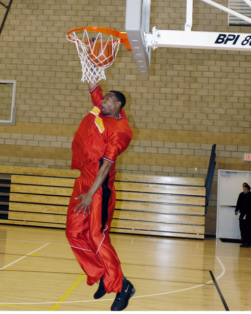 US Marine Corps (USMC) Sergeant (SGT) Jackson, assigned to Assault Craft Unit-5 dunks during a basketball practice on the new courts inside the newly opened Semper Fit Field House at Marine Corps Base (MCB), Camp Pendleton, California (CA)