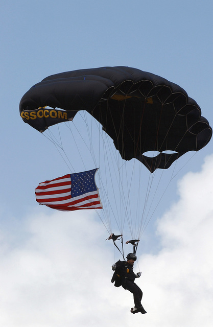 A US Special Operations Command (USSOCOM) Parachute team member descend onto Legends Field in Tampa, Florida (FL), on the opening day of Spring Training for the New York Yankees, who are about to play the Philadelphia Phillies