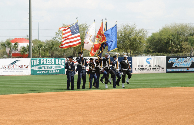 The US Special Operations Command (USSOCOM) Color Guard presents the colors at Legends Field in Tampa, Florida (FL), on the opening day of Spring Training for the New York Yankees, who are about to play the Philadelphia Phillies