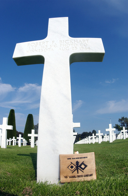 Tombstone of US Army (USA) First Lieutenant (1LT) Robert F. Bickhart, from Minnesota, 165th Signal PHOTO Company, killed in action (KIA) August 25, 1944, during World War II is buried in the American Cemetery at Colleville-sur-Mer above Omaha Beach, France (FRA)