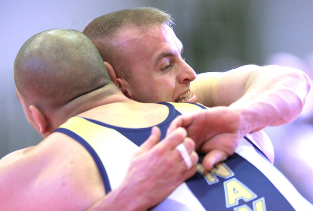 US Marine Corps (USMC) Captain (CPT) Frank Workman (background), a member of the All Marines Wrestling Team, competes in a Greco Roman wresting match against a member of the All US Navy (USN) Team, during the Armed Forces Wrestling Championship held in New Orleans, Louisiana (LA)