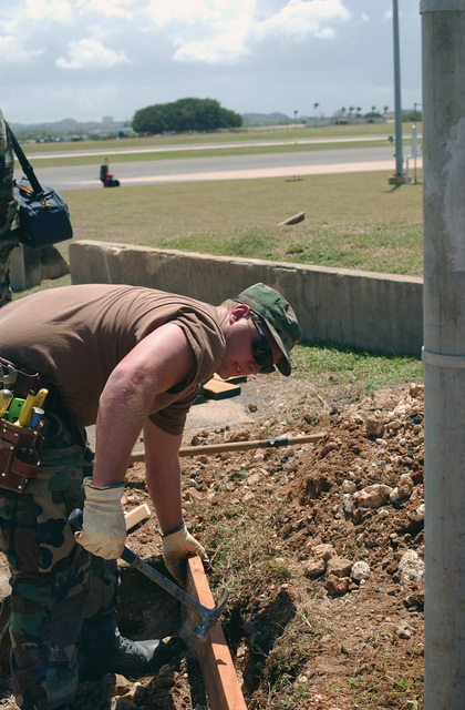 US Air Force (USAF) STAFF Sergeant (SSGT) Shawn Parker, 124th Civil Engineer Squadron (CES), hammers in a concrete form during a construction project at the Borrenquin Coast Guard Air Station, Puerto Rico