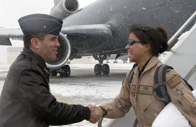 US Air Force (USAF) Colonel (COL) Scott Chestnut (left), 305th Operations Group Commander, greets First Lieutenant (1LT) Elizabeth Chock, 305th Operations Support Squadron (OSS), as she disembarks from a USAF KC-10 Extender aircraft at McGuire Air Force Base (AFB), New Jersey (NJ). 1LT Chock and members of her Unit are returning home following a 60-day deployment in support of Operation IRAQI FREEDOM
