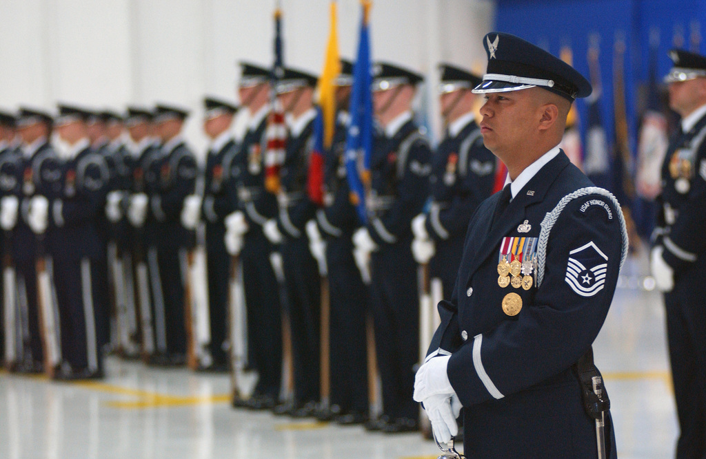 US Air Force (USAF) MASTER Sergeant (MSGT) Edgardo Onas (foreground), a member of the USAF Honor Guard, stands at parade rest prior to the start of the indoor Full Honors Arrival Ceremony being held for the Columbian Air CHIEF, inside Hangar 3 at Andrews Air Force Base (AFB), Maryland (MD)