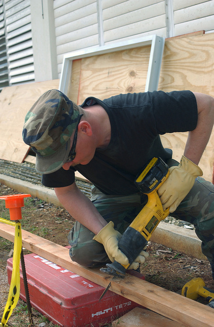 US Air Force (USAF) MASTER Sergeant (MSGT) Jess Ellis, 124th Civil Engineering Squadron (CES) cuts a framing board during a base improvement project at the Child Development Center at Coast Guard Air Station (CGAS) Borinquen, Puerto Rico