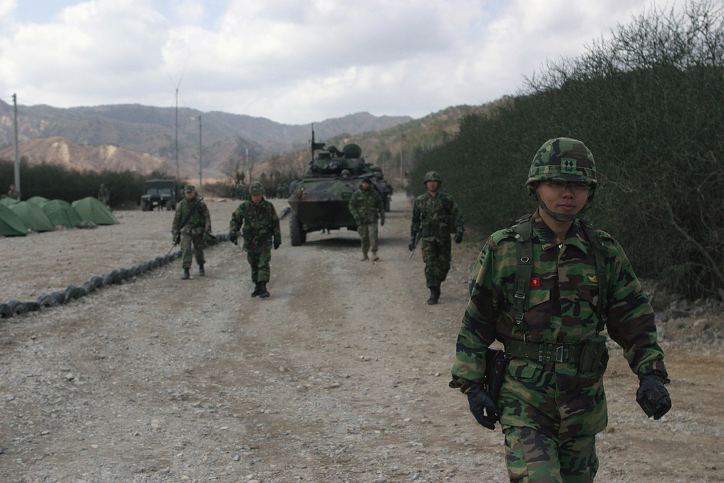 Republic of Korea (KOR) Marines and US Marine Corps (USMC) Marines assigned to the 3rd Light Armored Reconnaissance Battalion (LARB), return to their staging areas, after completing training at Su Song Ri, Republic of Korea (KOR), while participating in the Amphibious Ready Group Exercise 2004 (ARGEX 04). The Exercise is jointly conducted between the USMC and the US Navy (USN) and the KOR, and is designed to familiarize each Unit with the techniques, tactics, and procedures associated with a Special Operations Capable (SOC) Unit