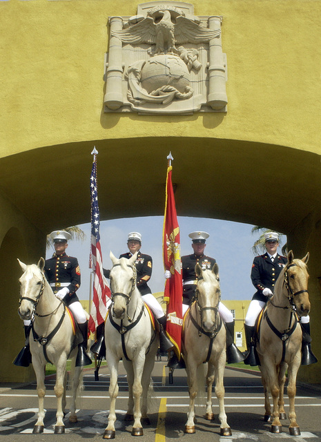 The US Marine Corps (USMC) Mounted Color Guard, from Marine Corps Logistics Base (MCLB) Barstow, California (CA), are in parade formation under the Marine Corps Recruit Depot (MCRD) San Diego, CA, stone Eagle, Globe, and Anchor following the Headquarters and Service (H&S) Battalion (BN) Post and Relief Ceremony. The members are (l to r) Sergeant (SGT) Phillip Morris, MASTER GUNNERY Sergeant (MGYSGT) Kim Ortamond, GUNNERY Sergeant (GYSGT) Scott McCloud, and Lance Corporal (LCPL) Christol Powell