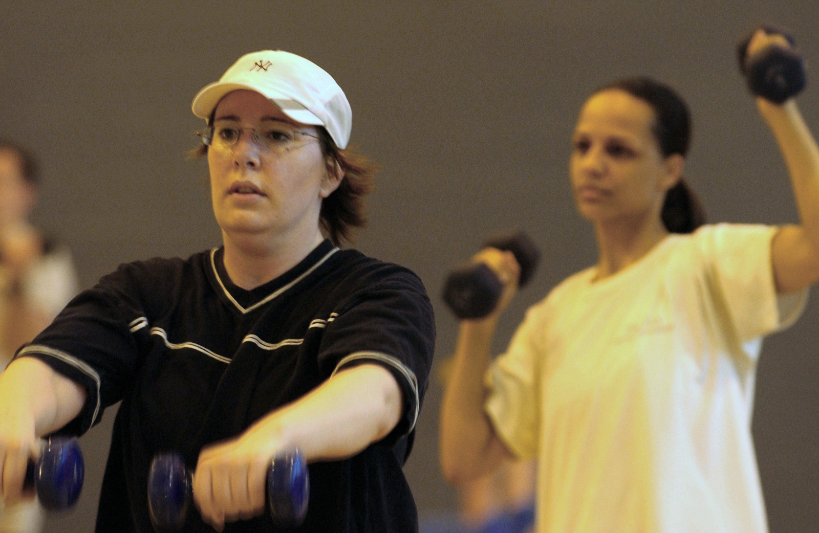 US Air Force (USAF) Technical Sergeant (TSGT) Erica Bairos (left) and TSGT Angie Harris, both assigned to 3rd Air Force (3AF), participate in a Combat Fitness Circuit Training Class held at the Royal Air Force (RAF) Mildenhall base fitness center, in England (ENG)