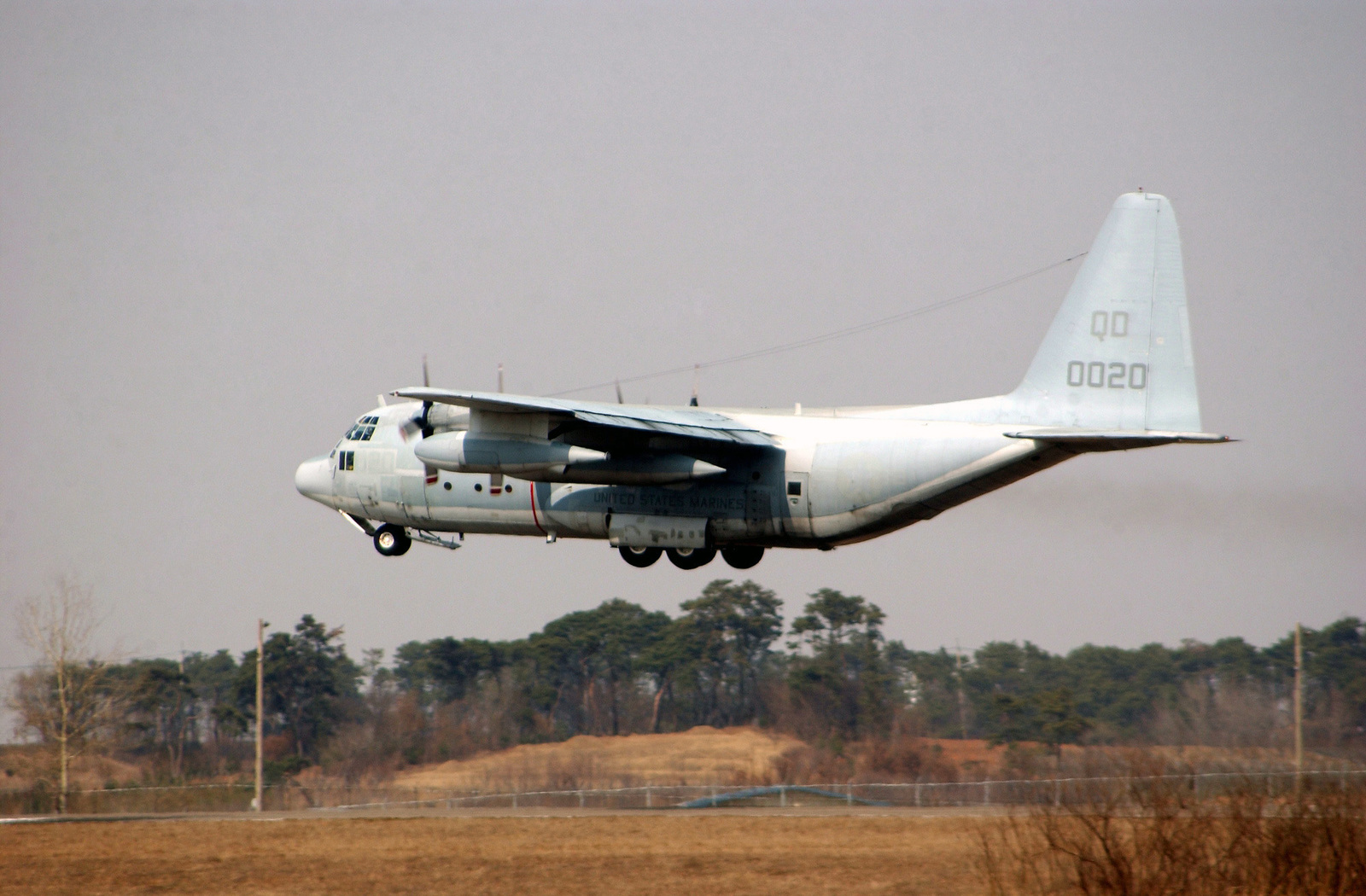 A US Marine Corps (USMC) Marine Wing Support Squadron (MWSS) 172 (MWSS-172), Marine Wing Support Group (MWSG) 17 (MWSG-17), 1ST Marine Aircraft Wing (MAW), C-130 Hercules cargo aircraft takes off from the flight line at Camp Humphreys, near Pyongtaek, Gyeonggi-do Province, Republic of Korea (KOR), while participating in Korea Field Training Exercise 2004 (FTX 2004). Korea FTX 04 is part of a Reception Staging Onward Moving and Integration (RSO&I) theater-level training exercise designed to test the 1ST MAWs ability to rapidly deploy its command and control function to the Korean Peninsula