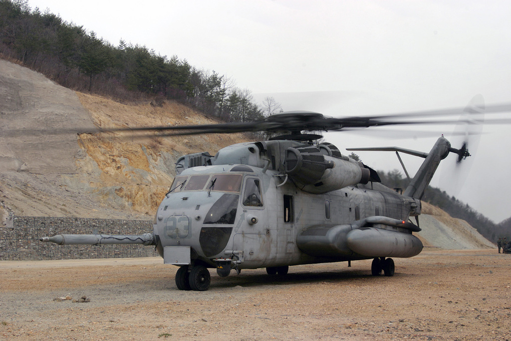 A US Marine Corps (USMC) 31st Marine Expeditionary Unit (MEU) Special Operations Capable (SOC) Unit, CH-53E cargo helicopter prepares to take off from a landing zone (LZ) on Camp Mujuk, located near Pohang, Gyeongsangbuk-do Province, Republic of Korea (KOR), after airlifting two Republic of Korea Marine Corps (ROKMC) howitzers during a joint USMC and ROKMC training exercise conducted as part of Amphibious Ready Group Exercise 2004 (ARGEX 04). ARGEX 04 is a joint USMC and US Navy (USN) training exercise designed to acquaint each service about the techniques, tactics, and procedures associated with the deployment of a MEU(SOC) Unit