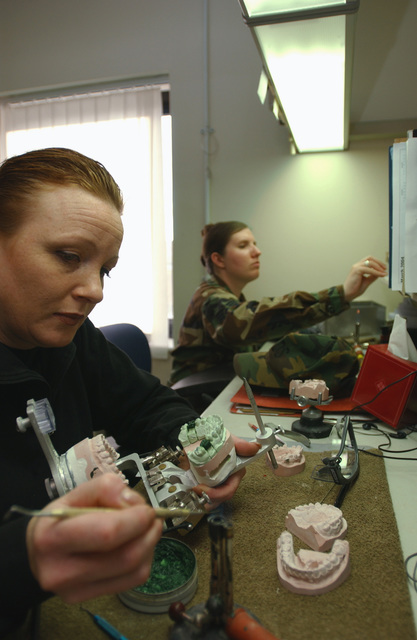 US Air Force (USAF) Technical Sergeant (TSGT) Jodi Hildebrandt, Dental Laboratory Craftsman with the 48th Dental Squadron (DS), 48th Fighter Wing (FW), Royal Air Force (RAF) Lakenheath, England (ENG), uses melted wax to make a mold for a gold tooth crown