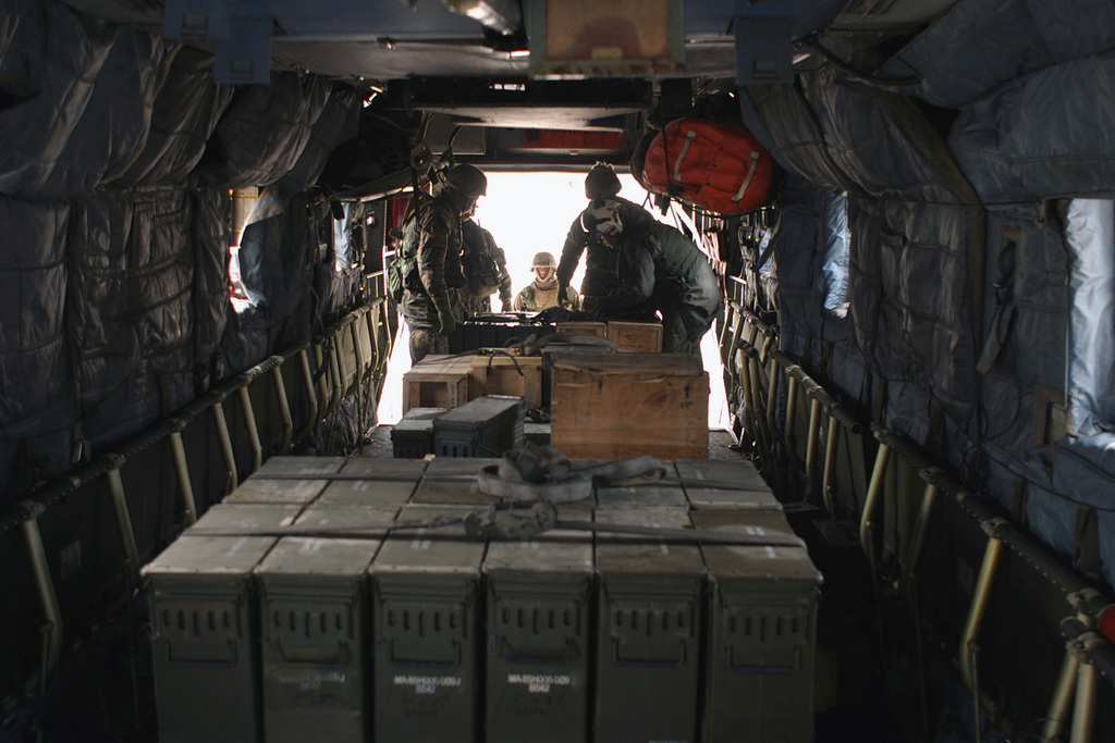 US Marine Corps (USMC) 31st Marine Expeditionary Unit (MEU) Special Operations Capable (SOC) Unit Marines load ammunition boxes onboard a 31st MEU(SOC) CH-53E cargo helicopter at an ammunition supply point at Su Song Ri Range, near Pohang, Gyeongsangbuk-do Province, Republic of Korea (KOR), so it can transport the ammunition back to the US Navy (USN) Wasp Class Amphibious Assault Ship, USS ESSEX (LHD 2), at the end of Amphibious Ready Group Exercise 2004 (ARGEX 04). ARGEX 04 was a joint USMC and USN training exercise designed to acquaint each service about the techniques, tactics, and procedures associated with the deployment of a MEU(SOC) Unit