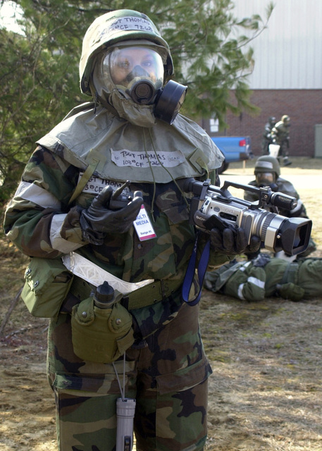Connecticut Air National Guard (CTANG) Technical Sergeant (TSGT) Michelle Thomas, Videographer, 103rd Communication Flight (CF), 103rd Fight Wing (FW), Bradley Air National Guard Base (ANGB), East Granby, Connecticut (CT), prepares to record a post-attack reconnaissance operation after a simulated attack during Operation YANKEE FREEDOM, the March 2004 Operational Readiness Exercise (ORE) / Operational Readiness Inspection (ORI) being conducted on Bradley ANGB