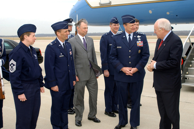 Dick Cheney (right), Vice President of the United States, stands on the tarmac at Wright-Patterson (WP) Air Force Base (AFB), Ohio (OH), talking with US Air Force (USAF) eneral (EN) regory S. Martin (second from right), Commander, Air Force Material Command (AFMC). Waiting to greet the Vice President at the start of his official visit is (left to right) USAF CHIEF MASTER Sergeant (CMST) Vicki Maudlin, Command CHIEF MASTER Sergeant (CCM), AFMC; USAF Colonel (COL) Mike Belzil; Mr. Bob May, SES; USAF Brigadier eneral (BEN) Ted Bowlds (standing left behind EN Martin), Deputy for Acquisition, Aeronautical Systems Center (ASC), WP AFB, OH; and Mr. Dan Stewart, SES (standing right behind...