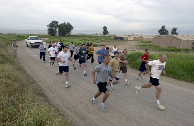 Early in the morning, US service members at Kirkuk Air Base (AB), Iraq, begin a 10 Kilometer (6.21 Miles) run sponsored by the 506th Expeditionary Services Squadron (ESVS) during Operation IRAQI FREEDOM