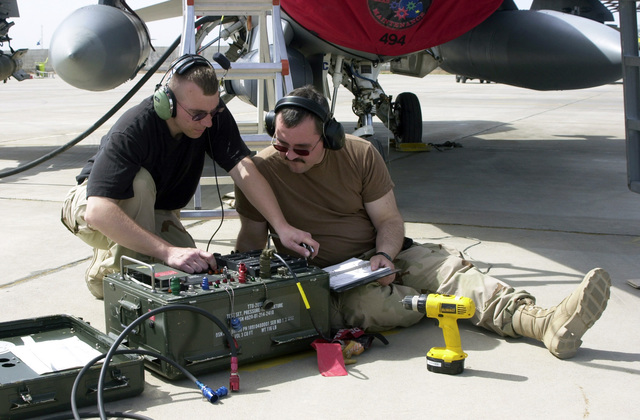 Michigan Air National Guard (MIANG) STAFF Sergeant (SSGT) Mike Mazure (left) and SSGT Ron Davenport (right), 107th Fighter Squadron (FS), Selfridge Air National Guard Base (ANGB), Michigan (MI), run a test on an F-16 Fighting Falcon fighter aircraft Pitot tube, which is used to record air speed, temperature, altitude, and elevation, at Kirkuk Air Base (AB), At Ta Mim Province, Iraq (IRQ), while deployed to conduct an Armed Reconnaissance mission during Operation IRAQI FREEDOM