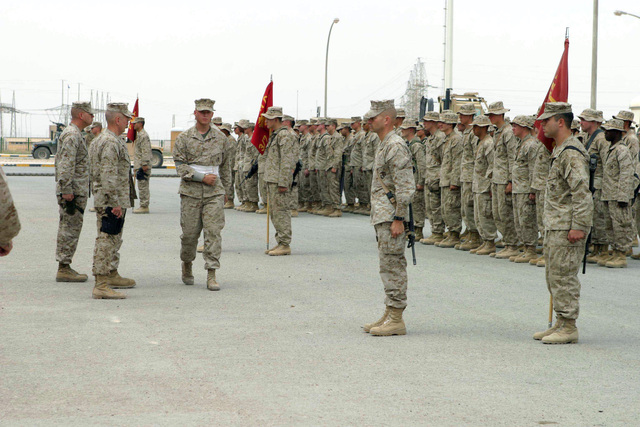 US Marine Corps (USMC) Marines, 3rd Battalion (BN), 7th Marine Regiment (3/7th MAR), 1ST MARDIV, conduct a Purple Heart Ceremony for USMC Lance Corporal (LCPL) Peter Hanson on the Parade Ground at Forward Operating Base (FOB) Camp Al Qaim (Qaim), Al Anbar Province, Iraq (IRQ), during Operation IRAQI FREEDOM. Officiating and presenting the Purple Heart are USMC Lieutenant General (LGEN) James T. Conway, Commanding General (CG), I Marine Expeditionary Force (MEF), and USMC Major General (MGEN) James N. Mattis, CG, 1ST MARDIV