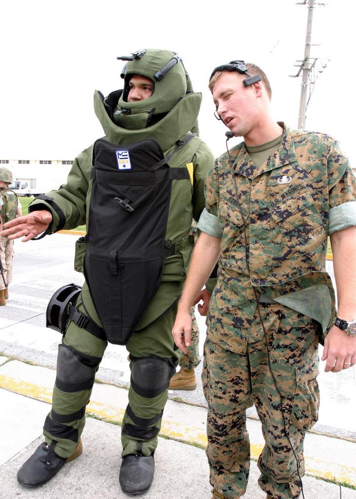 US Marine Corps (USMC) Sergeant (SGT) Lauro Samaniego (left