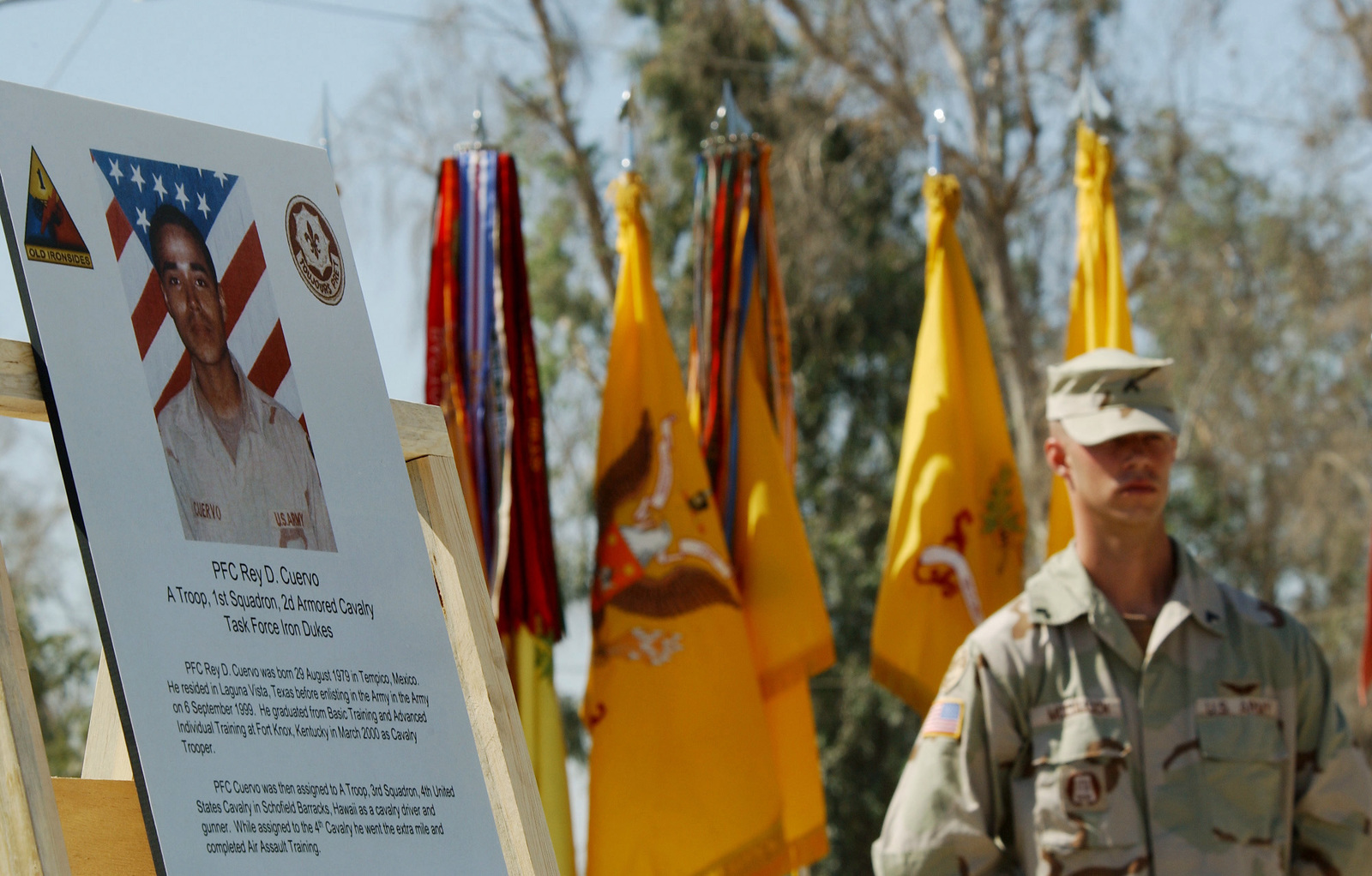 A Member of the US Army (USA), 2nd Armored Calvary Regiment stands in front of the colors during a Forward Operating Base (FOB) Dedication Ceremony for Private First Class (PFC) Rey D. Cuervo, near Baghdad, Iraq (IRQ). He was killed while deployed with the 2nd Armored Calvary in support of Operation IRAQI FREEDOM