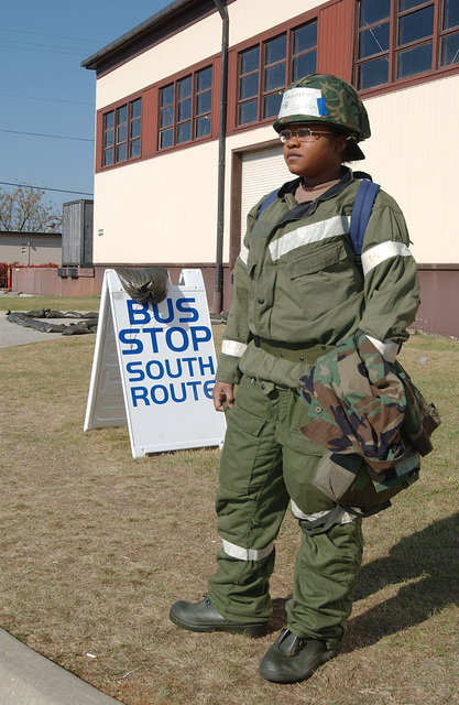 At Shaw Air Force Base (AFB), South Carolina (SC), US Air Force (USAF) AIRMAN First Class (A1C) Veronica Magloire with the 20th Operational Support Squadron (OSS), waits for a bus to arrive as she begins her day during a phase II exercise