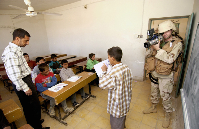 US Air Force (USAF) STAFF Sergeant (SSGT) Kevin Davidson, Combat Videographer, Logistics Support Area (LAS) Anaconda, documents classroom activities at a school in the town of Al Rafae, Iraq during Operation IRAQI FREEDOM