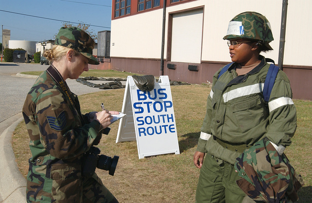 US Air Force (USAF) Technical Sergeant (TSG) Shirley Henderson, photographer with the 20th Communications Squadron (CS), jots down information about AIRMAN First Class (A1C) Veronica Magloire with the 20th Operational Support Squadron (OSS), for a cutline in a photograph during a phase II exercise