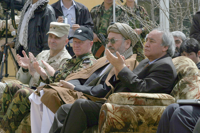 Members of the official party attend a ceremony commemorating the reopening of the University, located in Bamian Afghanistan, during Operation ENDURING FREEDOM. The ceremony is the result of more than a year of re-construction, with funding of almost $600,000 from the United States and New Zealand. Pictured left-to-right are: US Army (USA) Colonel (COL) Anthony Cucolo, Deputy Commander, Combined Joint Task Force-180; Zealand Defense Force Group Captain Gavin Howse; Democratic Republic of Afghanistan Vice-President Mohammad Abdul Karim Khalili; and Dr. Mohammad Sharif Faiz, Democratic Republic of Afghanistan, Minister of Higher Education