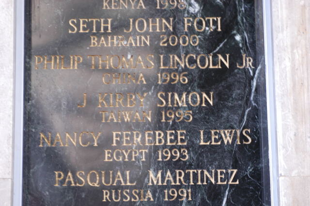 [Assignment: 59-CF-DS-13074-04] Views of American Foreign Service Association Memorial Plaque in C Street Lobby, Harry S. Truman Building.  [Among names is that of J. Kirby Simon, a foreign service officer who died while serving in Taiwan in 1995--and the namesake for the J. Kirby Simon Foreign Service Trust, dedicated to international assistance projects.] [Photographer: Mark Stewart--State] [59-CF-DS-13074-04_DSC_0279.JPG]