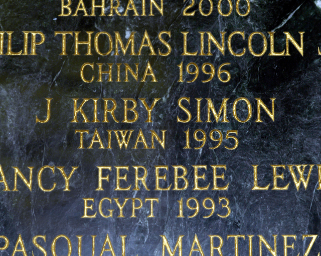 [Assignment: 59-CF-DS-13074-04] Views of American Foreign Service Association Memorial Plaque in C Street Lobby, Harry S. Truman Building.  [Among names is that of J. Kirby Simon, a foreign service officer who died while serving in Taiwan in 1995--and the namesake for the J. Kirby Simon Foreign Service Trust, dedicated to international assistance projects.] [Photographer: Mark Stewart--State] [59-CF-DS-13074-04_AFSA1_fromPSD.jpg]