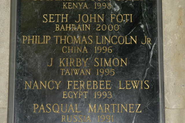 [Assignment: 59-CF-DS-13074-04] Views of American Foreign Service Association Memorial Plaque in C Street Lobby, Harry S. Truman Building.  [Among names is that of J. Kirby Simon, a foreign service officer who died while serving in Taiwan in 1995--and the namesake for the J. Kirby Simon Foreign Service Trust, dedicated to international assistance projects.] [Photographer: Mark Stewart--State] [59-CF-DS-13074-04_DSC_0281.JPG]