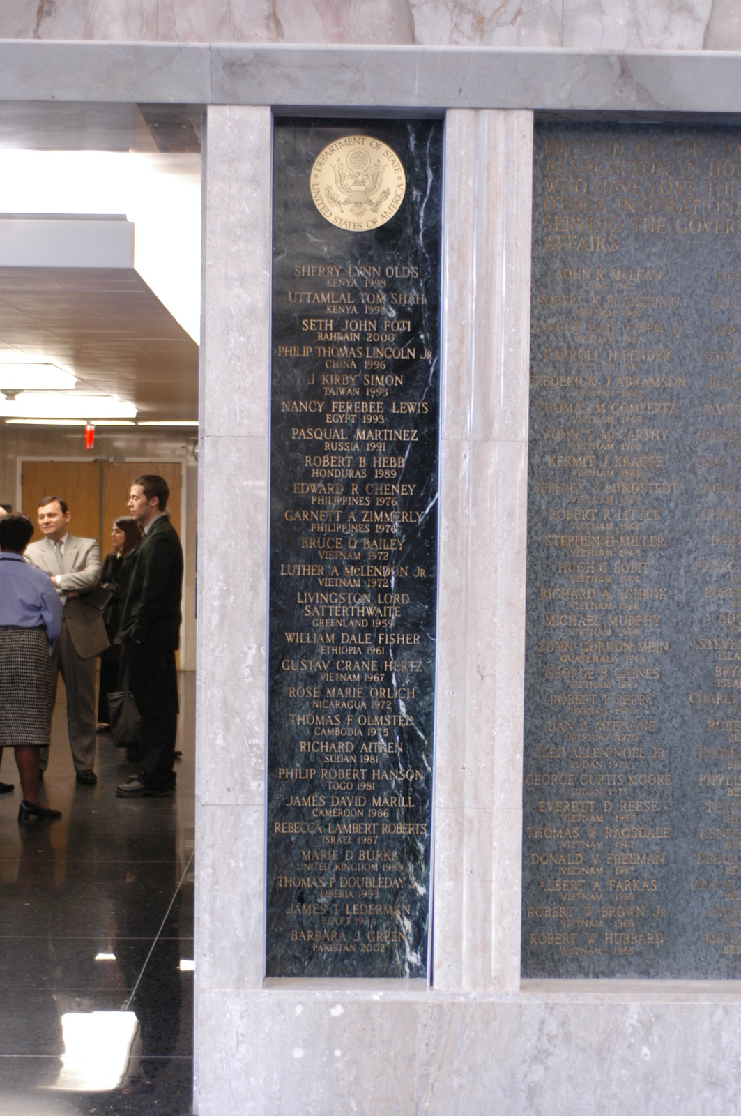 [Assignment: 59-CF-DS-13074-04] Views of American Foreign Service Association Memorial Plaque in C Street Lobby, Harry S. Truman Building.  [Among names is that of J. Kirby Simon, a foreign service officer who died while serving in Taiwan in 1995--and the namesake for the J. Kirby Simon Foreign Service Trust, dedicated to international assistance projects.] [Photographer: Mark Stewart--State] [59-CF-DS-13074-04_DSC_0265.JPG]