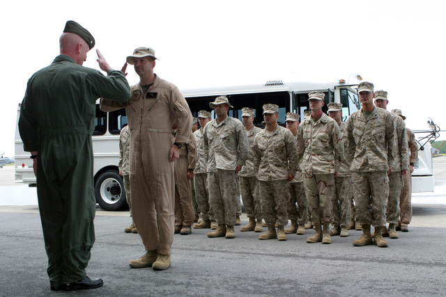 US Marine Corps Reserve (USMCR) Lieutenant Colonel (LCT) Milner (foreground) Commanding Officer (CO) Marine Air Group Four Two (MAG-42) Detachment C, salute an assembled platoon of his Marines assigned to Marine Light Attack Helicopter Squadron Seven Seven Three (HMLA-773) returning home at Naval Air Station/Joint Reserve Base (NAS/JRB), Belle Chasse, Louisiana (LA), following a six-month deployment to Afghanistan in support of Operation ENDURING FREEDOM