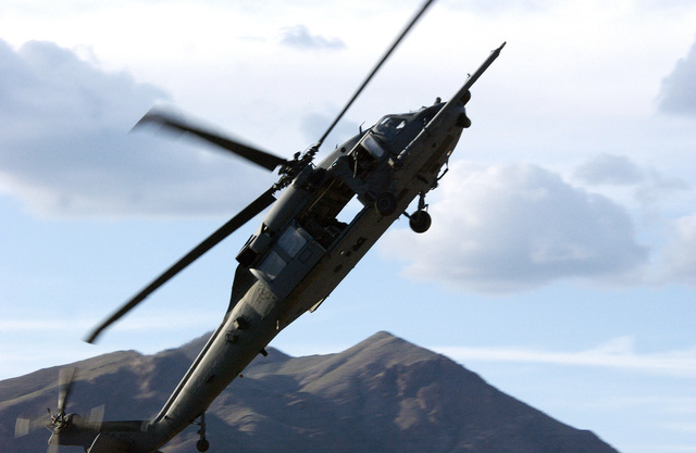 A US Air Force (USAF) HH-60G Pave Hawk, 66th Rescue Squadron (RS), Nellis Air Force Base (AFB), Nevada (NV), performs a maximum take off during a live fire training exercise held at Ft. Bliss, Texas (TX). The exercise is part of the 57th Wing Weapons School, Nellis AFB, NV, intensive five-month training program. The exercise concentrates on the HH-60 Weapons School Division students performing flying tasks while combining integrated training with the 66th RS as part of the course curriculum. The mission of the USAF Weapons School (USAFWS) is to teach graduate-level instructor courses that provides the world's most advanced training in weapons and tactics employment to officers of the...