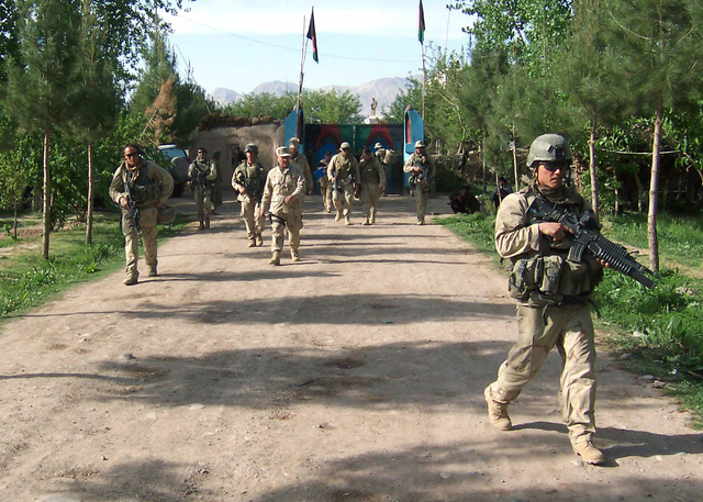US Marine Corps (USMC) Force Recon (Reconnaissance) Marines, 22nd Marine Expeditionary Unit (MEU) Special Operations Capable (SOC), provide security for their unit commander as he begins a tour of the area starting at the Governors Compound in the Tirin Kot District, Oruzgan Province, Afghanistan (AFG), while conducting an overt vehicular reconnaissance patrol throughout the Kandahar and Oruzgan Provinces of Afghanistan during Operation ULYSSES II, which is the first combat operation undertaken by the 22nd MEU (SOC) during Operation ENDURING FREEDOM