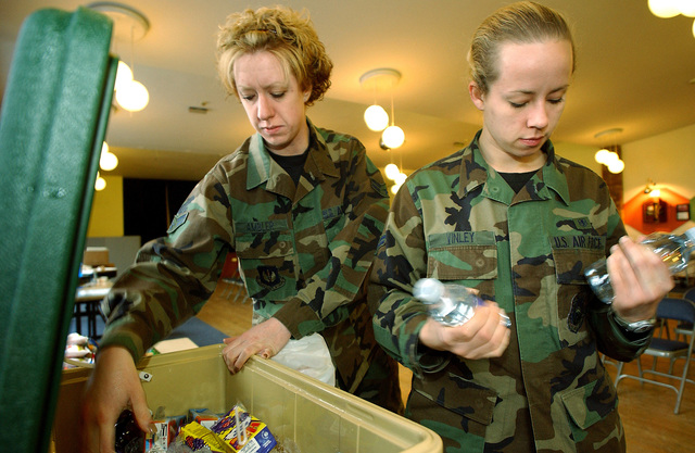 US Air Force (USAF) Airmen First Class (A1C) Stephanie Ambler (left) and Cherish Vinley, 48th Medical Support Squadron (MDSS), load a cooler full of beverages during a monthly blood drive at the Bob Hope Community Center on RAF (Royal Air Force) Mildenhall, United Kingdom (UK). The volunteers are encouraged to have something to drink and eat after donating to prevent dizziness due to the loss of blood