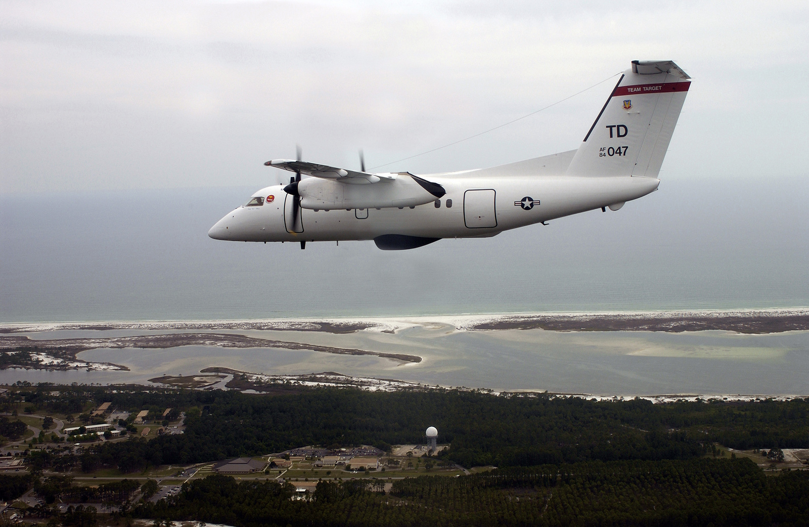 A US Air Force (USAF) E-9A Widget, a unique test support asset flown by the 82nd Aerial Targets Squadron (ATS), Tyndall Air Force Base (AFB), Florida (FL). This E-9A is one of only two aircraft in the USAF inventory and is used as an airborne platform and telemetry relay aircraft to provide ocean surface surveillance and to relay missile and target telemetry of missiles fired in over the horizon profiles on the Gulf Ranges