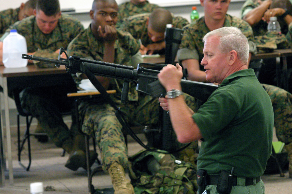 Mr. Pat Rogers, E.A.G. Tactical, instructs US Marine Corps (USMC) 3rd Battalion (BN), 5th Marine Regiment (3/5th MARS), 1ST Marine Division (MARDIV), Marines about carrying out as immediate action due to a weapon malfunction as part of the E.A.G. Tactical Training Gun Fighting Course being taught at the 3/5th MARS Regimental Instructional Facility, located at Camp San Mateo (62 Area), Marine Corps Base (MCB) Camp Pendleton, California (CA)