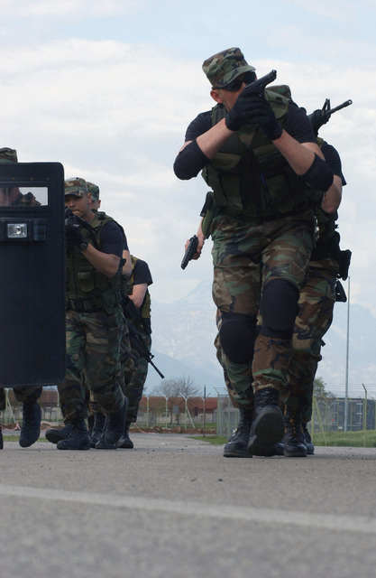 US Air Force (USAF) Security Police (SP) assigned to the 31st Security Forces Squadron (SFS), conduct vehicle assault training as part of a tactics-training course held at Aviano Air Base (AB), Italy. The weeklong course was developed to establish a better working relationship between members of the Office of Special Investigations (OSI), the 31st SFS, and the Italian Air Force Carabineri