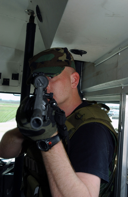 US Air Force (USAF) STAFF Sergeant (SSGT) Paul Ruhbusch, 31st Security Forces Squadron (SFS), armed with a 5.56 mm M16A2 rifle, participates in vehicle assault training as part of a tactics-training course held at Aviano Air Base (AB), Italy. The weeklong course was developed to establish a better working relationship between members of the Office of Special Investigations (OSI), the 31st SFS, and the Italian Air Force Carabineri