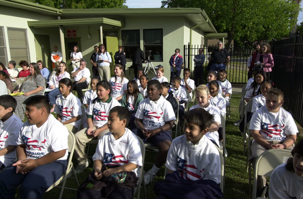 Audience listening to speaker highlighting Take Pride in America school grounds beautification event, attended by Secretary Gale Norton, at Cleveland Elementary School in Stockton, California