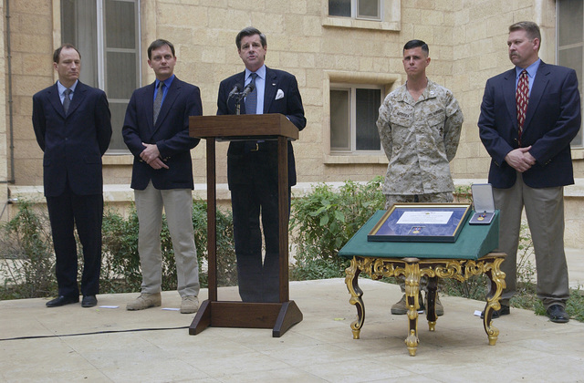 Civilian and Military dignitaries are on hand as the US Armed Services Medal of Valor is presented to a citizen of the United Kingdom (UK), during an Awards Ceremony held in Baghdad, Iraq, during Operation IRAQI FREEDOM. Pictured left-to-right: Mr. Andrew Rathmell (award recipient), Director of Planning, Policy, and Analysis, Coalition Provisional Authority Headquarters; United Kingdom (UK) Ambassador to Iraq, The Honorable David Richmond; US Ambassador to Iraq, The Honorable Paul Bremmer; US Marine Corps (USMC) Captain (CPT) Michael Cardozza; and Colonel (COL) Ralf Sabatino. Mr. Rathmell is the first civilian to receive the Medal of Valor since 9/11/2001