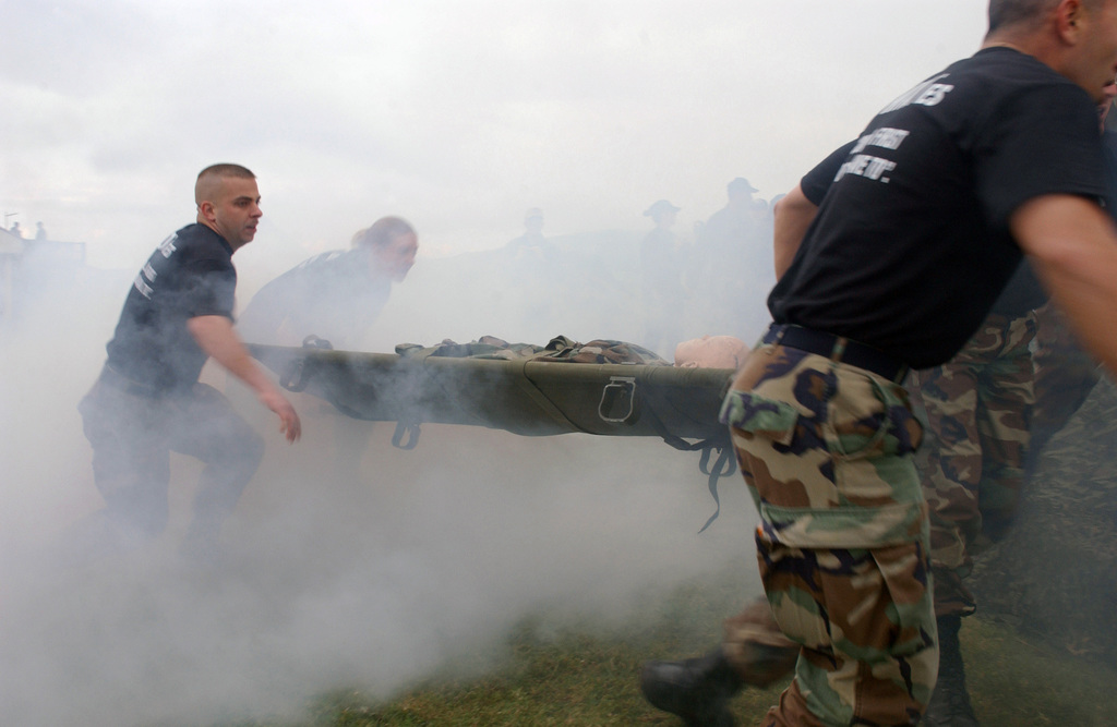 US Air Force (USAF) Airmen assigned to the 65th Communications Squadron (CS), carry their patient (training aid dummy) as they race to compete with several other squadrons during a Warrior Day, Mass Casualty Exercise held at Lajes Field, Azores, Portugal