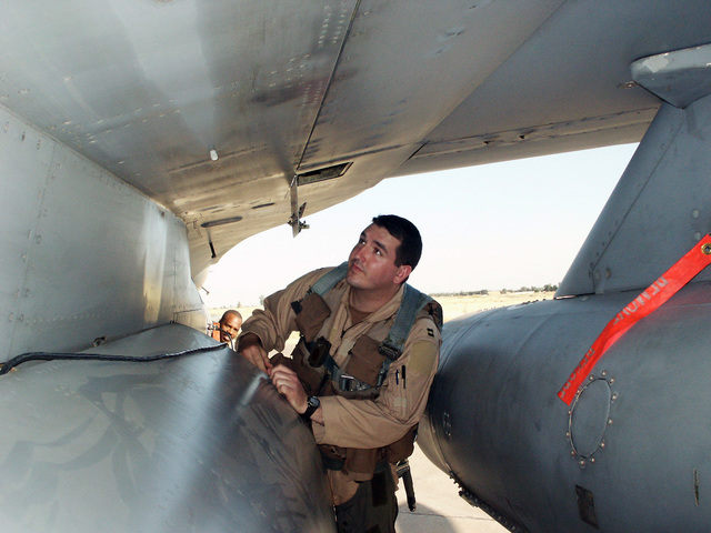 The 107th Fighter Squadron (FS) from Selfridge Air National Guard Base (ANGB), Michigan (MI), and its F-16 Fighting Falcon fighter aircraft are deployed to Kirkuk, Iraq (IRQ), in support of Operation IRAQI FREEDOM. Here Captain (CPT) Andy Aspey performs his pre-mission flight inspection